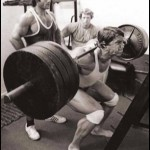 Ken Waller looks at Arnold Schwarzenegger squatting 305 pounds