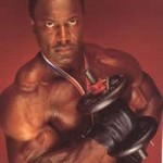 Lee Haney doing one armed dumbbell curls