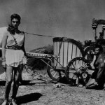 Steve Reeves with babe and chariot.