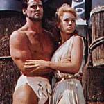 Steve Reeves with Mylène Demongeot on thee set of Giant of Marathon