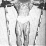 Steve Reeves holding up two barbells