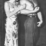 Steve Reeves with admiring high fashion model.