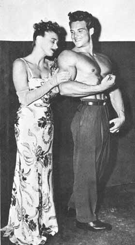 Steve Reeves with admiring lady.