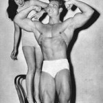 Fitness model points to Steve Reeves Biceps
