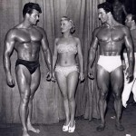 Steve Reeves chats with supermodel as Reg Park looks on.