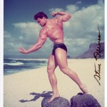 Steve Reeves poses atop two rocks at the beach.