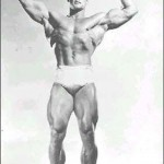 Steve Reeves doing a front double biceps pose