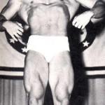 Steve Reeves posing on stage.