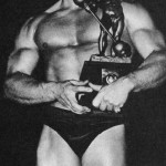 Steve Reeves with Sandow Trophy after winning contest
