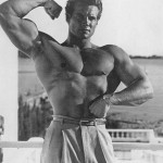 Actor and bodybuilder Steve Reeves hits an arm shot.